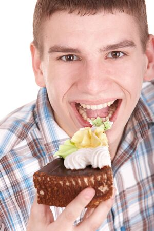 Face of man eating cake. Isolated. photo