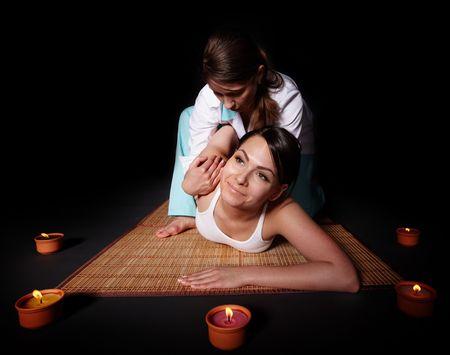 Beautiful white girl having thai massage. Beauty spa. photo