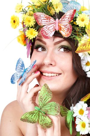 Girl with butterfly and flower on head. Spring hair. Isolated. Stock Photo - 6758219