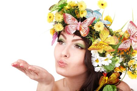 Girl with butterfly and flower on head. Spring hair. Isolated. photo
