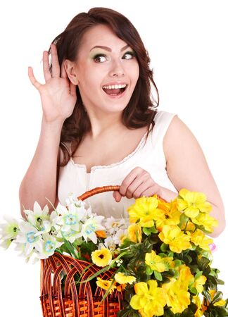 Beautiful girl with  spring flower and hand near ear. Isolated. photo