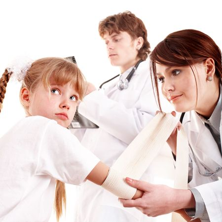 bandage: Group doctor treat happy child. First aid. Isolated. Stock Photo