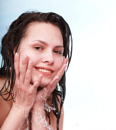 damping: Happy wet beautiful girl wash. Isolated.