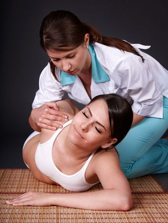 Beautiful white girl having thai massage. photo