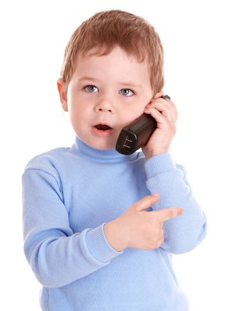 Boy in blue speak on phone. Isolated. photo