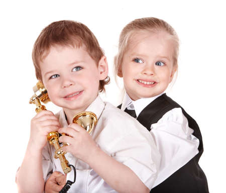 Children in business suit with telephone. Isolated. Stock Photo - 6964140