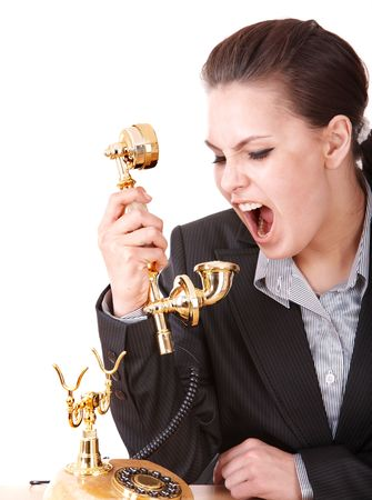 Aggressive businesswoman  with golden  phone. Isolated. Stock Photo - 6964154