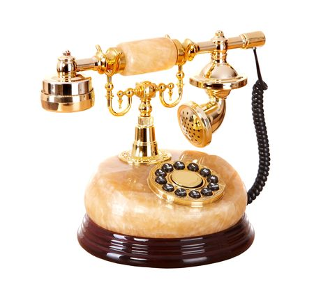 rotary phone: Old gold telephone from onyx. Isolated. Stock Photo