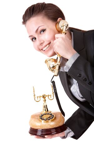Happy businesswoman with golden phone. Isolated. Stock Photo - 7072667