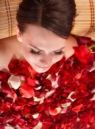 Beautiful young woman bathing with rose petal. Body care. Stock Photo - 7072736