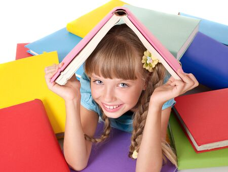 Little girl with pile of books on head. Isolated. photo