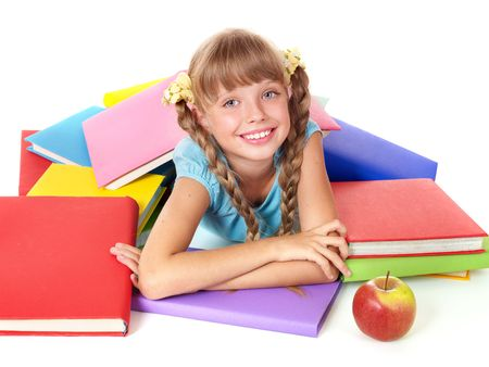 Little girl with pile of books and apple. Isolated. photo