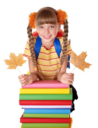 Girl holding autumn leaves and pile of books. Isolated. photo