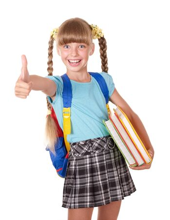 Schoolgirl with backpack holding books and showing thumb up. Isolated. photo