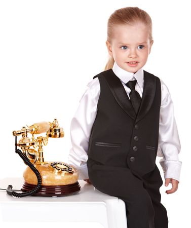 Little girl in business suit call telephone. Isolated. photo