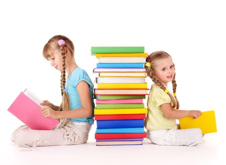 children reading books: Children reading pile of book. Isolated. Stock Photo