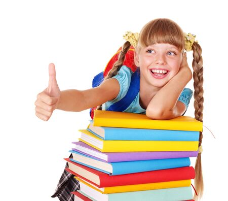 Schoolgirl with pile of books and showing thumb up. Isolated. photo