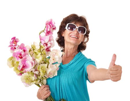 oap: Senior woman holding bunch of flowers. Isolated. Stock Photo