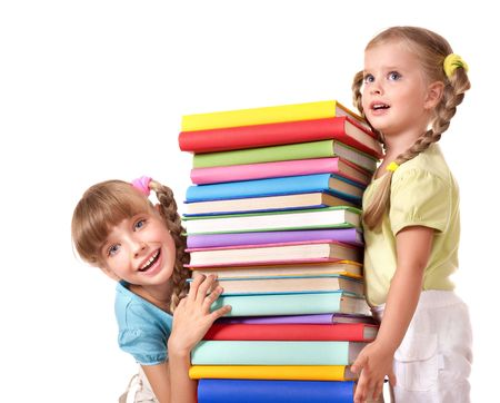 children studying: Children holding pile of book. Isolated.