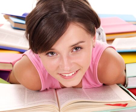 Girl reading open book on table. Isolated. Stock Photo - 7631304