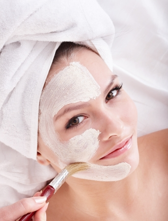 Young womanl with clay facial mask. Stock Photo - 7777835