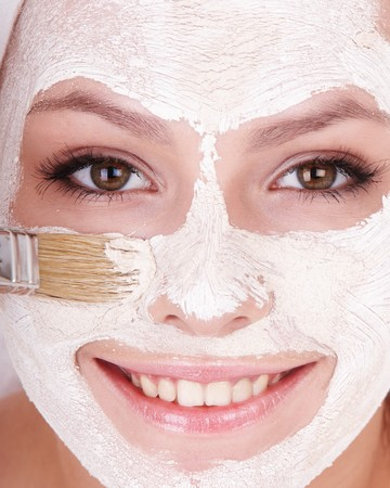 Young womanl with clay facial mask. Stock Photo - 7777804