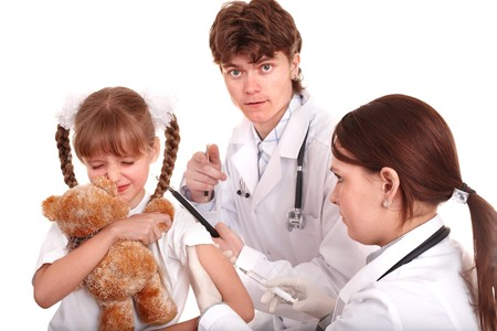 Doctor giving injection to child in arm. Isolated. Stock Photo - 7778693