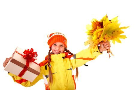 Little girl holding orange leaves and gift box. Isolated. Stock Photo - 7777914