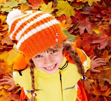 Little girl in autumn orange leaves. Outdoor. Stock Photo - 7778604