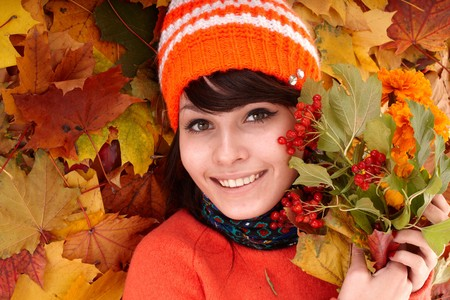 Girl in autumn orange leaves.  Outdoor. photo