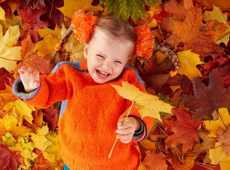 Little girl in autumn orange leaves. Outdoor. Stock Photo - 7778743