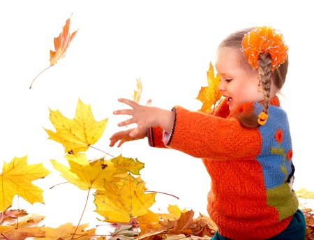 Little girl in autumn orange leaves. Isolated. photo