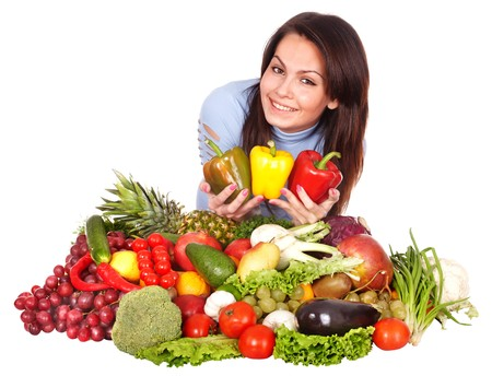 Girl with group of fruit and vegetables. Isolated. Stock Photo - 7778564
