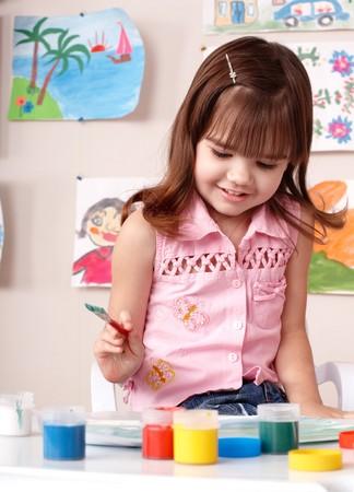 Child preschooler painting in classroom. Child care. Stock Photo - 7779137