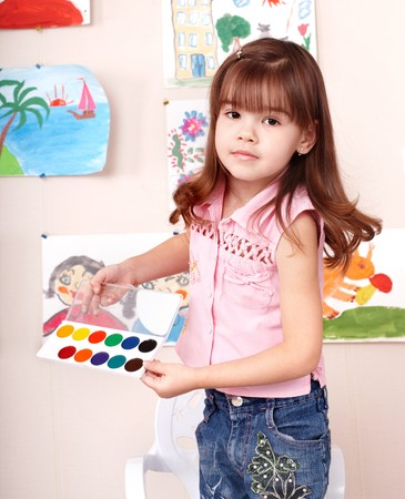 Child with paint  in art class . Preschool. Stock Photo - 7779135