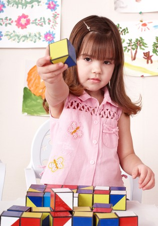 Little girl playing  block at home. photo