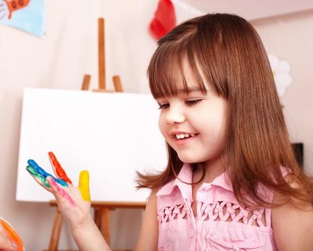 Child paint picture in preschool. Child care. photo