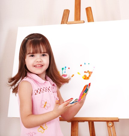 Little girl making handprints with paint. Stock Photo - 7778911