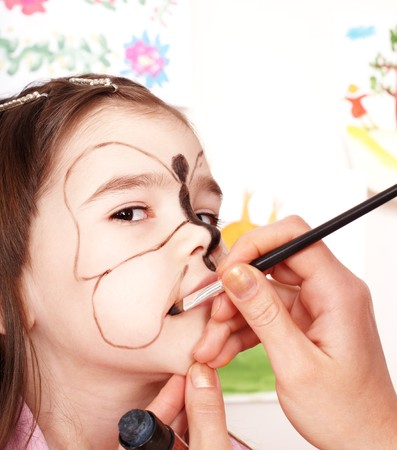 Child with face painting. Make up. photo