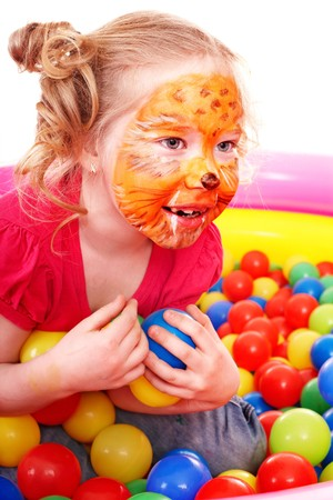 Little girl play colourful balls. Make up. Stock Photo - 7779727