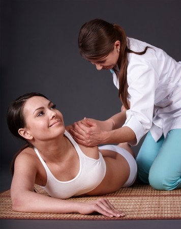 Young woman having thai massage. photo