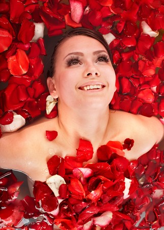 roseleaf: Beautiful girl in jacuzzi with rose petal. Body care.