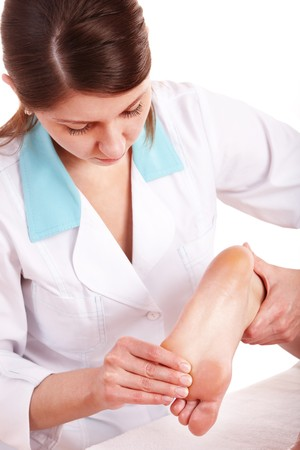 cosmetologist: Young woman having foot massage.