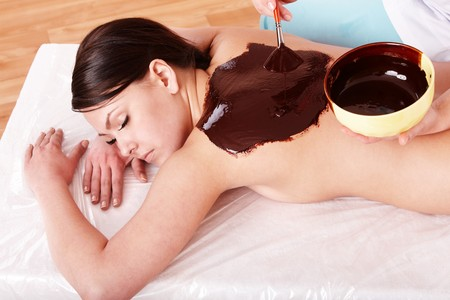 body mask: Young woman having chocolate body mask. Stock Photo