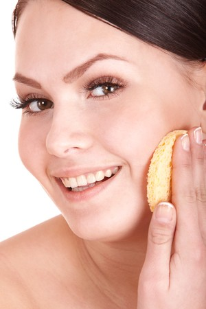 Young woman washing her face by sponge. Isolated. Stock Photo - 7778774