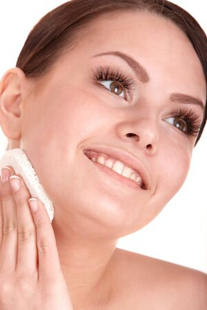 Young woman washing her face by sponge. Isolated. Stock Photo - 7779306