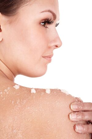 scrub: Beautiful young woman scrubbing body. Isolated.