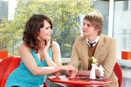 People dialog in restaurant. Loving couple. photo