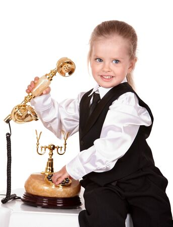 Child calling by phone. Isolated. photo