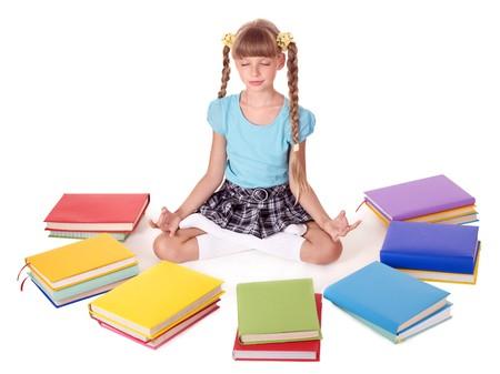 School child sitting lotus position. Isolated. photo